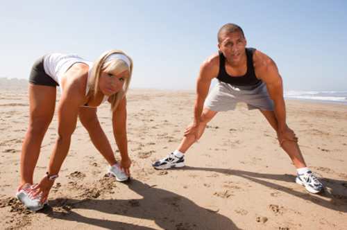 Stretching on the beach provides a soft surface and  eutiful scenery to view.