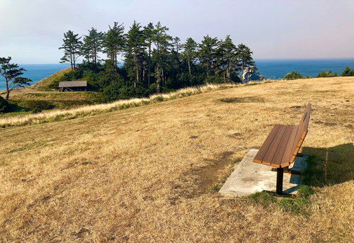 Bench at Ecola State Park looking out south to Cannon Beach.