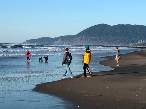 Families love bringing their children and dogs to Rockaway Beach on Thanksgiving Day.