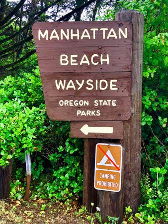 Entrance sign to Manhattan Beach State Park in Rockaway Beach Oregon.