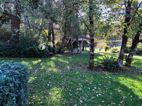 A stretch of beautifully maintained lawn will take you down to a covered picnic table.