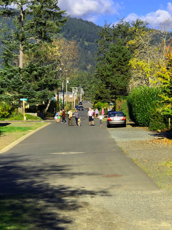 Parents and children walking down South 3rd St to Manzanita Park.