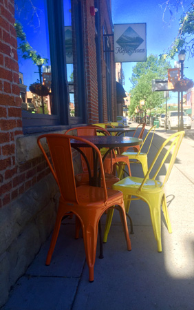 Colorful chairs on a quiet morning on Main Street in Bozeman Montana.