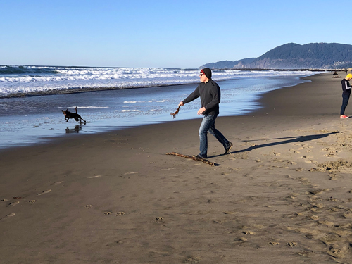 Dog owners are prevalent during Thanksgiving Day on Rockaway Beach.