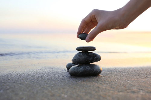 One of the benefits of stacking stones is that it forces you to be present and focus on finding balance.