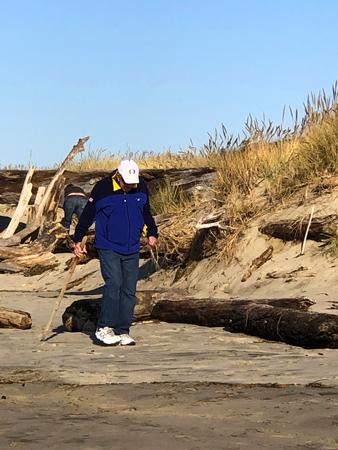 Walking on Rockaway Beach is a common activity.