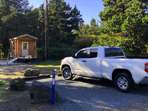 My 2018 Tundra parked in front of one of the portable cabins you can rent at Barview Jetty Park campground.