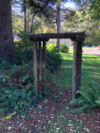 The trellis entrance is on the east side of Manzanita City Park.