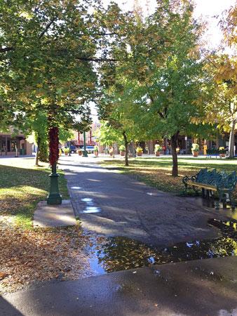 Rain puddles give a sense of peace to Santa Fe Plaza.