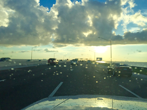 Driving over the Howard Franklin Bridge at sunrise. Starting my trip to Bozeman Montana.